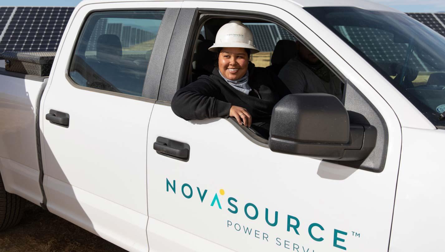 NovaSource worker in an O&M service truck
