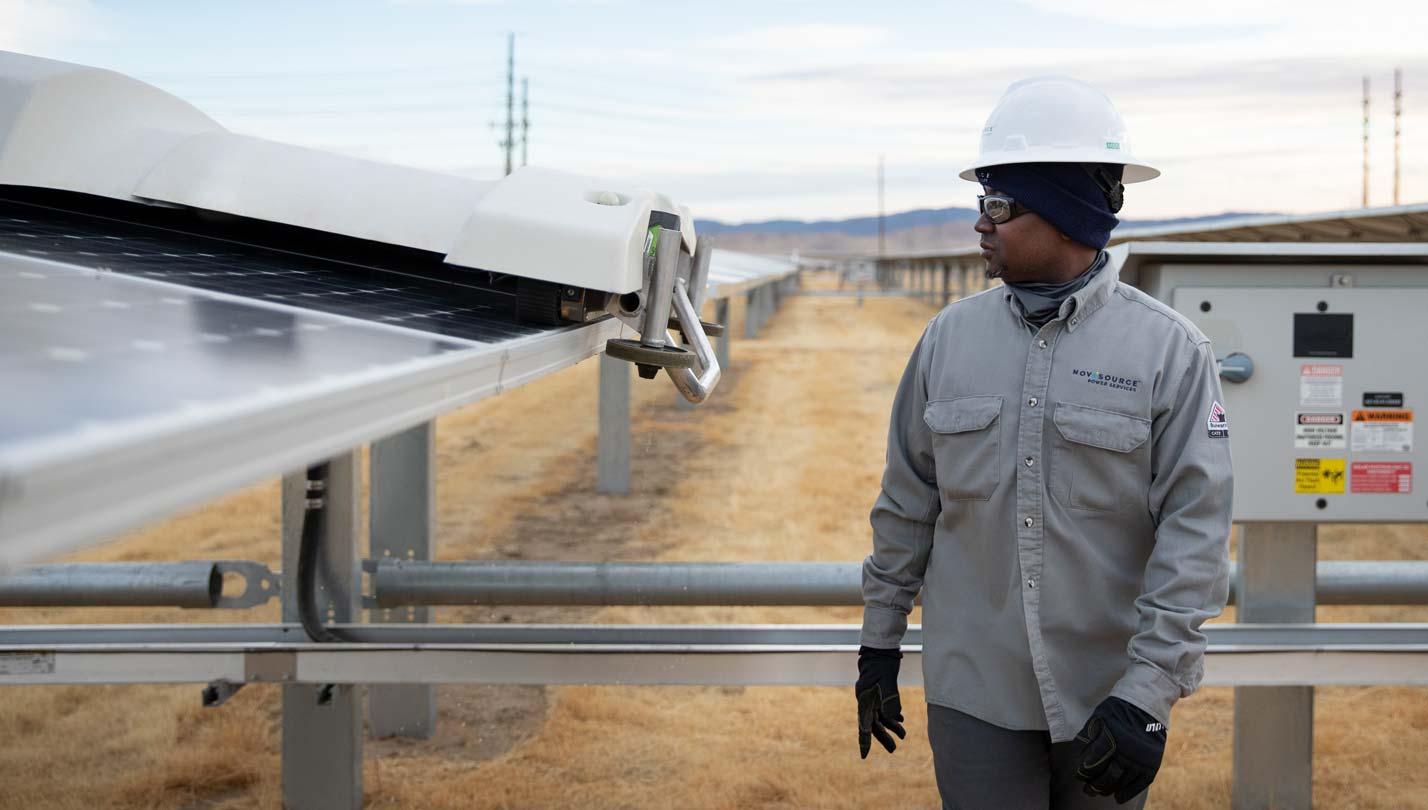 NovaSource worker monitoring solar panels